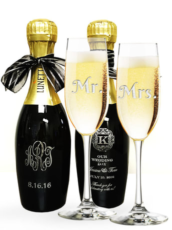 Engraved champagne glasses and bottles